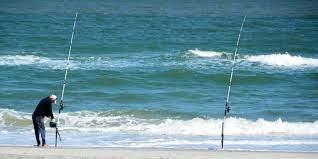 Photo of Pescadores a la orilla de la playa